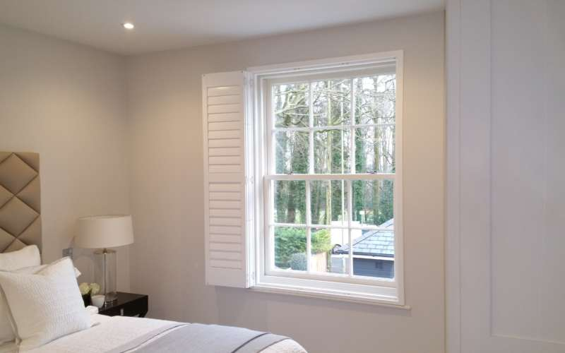 bedroom-window-shutters-open-Winchester-Hampshire-The-Great-Shutter-Co