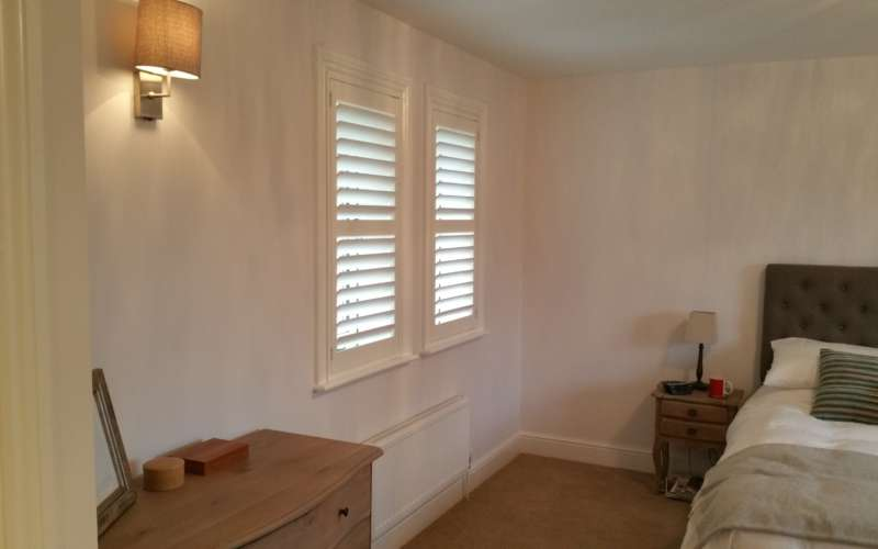 white-shutters-with-midrail-half-closed-andover-hampshire
